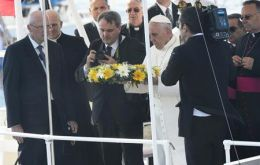 The Pope drops a wreath from an Italian coast guard vessel to remember the deceased migrants.
