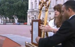 The news has been displayed on an ornate easel in the forecourt of Buckingham Palace in line with tradition.