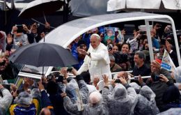 Tens of thousands turned out for Francis' mass despite the cold and rain