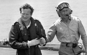 Sandy Woodward (left) arriving aboard HMS Hermes to assume command of the Falklands task force in 1982. (Photo: PA)