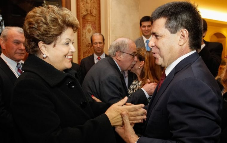 Cartes receives Brazilian president Dilma Rousseff (L) at his residence Wednesday evening