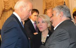 Mujica and Biden (R) meet at the Waldorf Astoria
