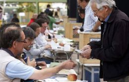 Chilean voters depositing their ballots, but an even greater number did not attend