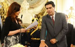 Cabinet chief Capitanich is sworn in at the Casa Rosada ceremony