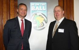FCO Minister Mark Simmonds (L) and Kevin Miles, FSF Chairman (R) urge Brits to be on the ball