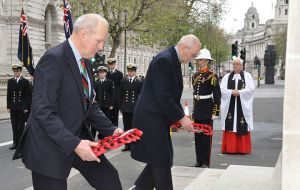 Colonel Mike Bowles laying the wreath for the 1982 veterans organisation SAMA-82 and Mr. Stuart Leeming laying the wreath for the Falklands Families Association