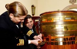Commander Sarah West followed the tradition of nailing a brass plaque bearing the ship's name onto a barrel of rum