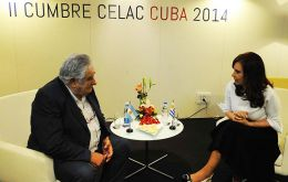 The Uruguayan president with Cristina Fernandez in Cuba