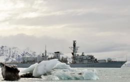 The Type 23 frigate sailing among icy landscape in the extreme south Atlantic