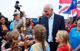 MLA Summers holding the baton surrounded by children (Pic by FIOGA)