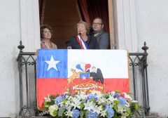 From a balcony at Government house in Santiago, Bachelet addresses the crowd