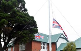 Recreation of the raising of the British standard outside Government House