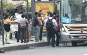 Crowds of people at bus stops in Rio do Janeiro