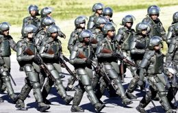 The Brazilian foot police have been equipped with sets of 'Rob-Cop' armor to contain protests  (Pic AP)