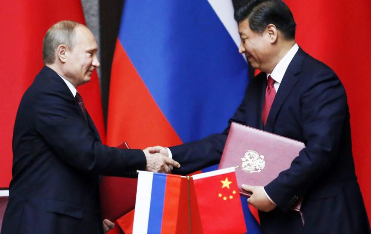 Presidents Putin and Xi Jinping in Beijing when the final agreement was announced