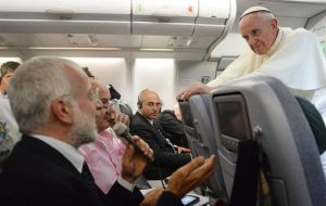 "Talking to reporters on his return flight from the Middle East, Pope Francis said ""there are married priests in the Church"""