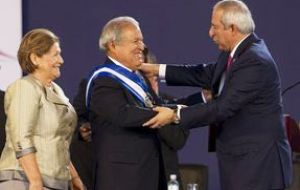The presidential sash was presented to Sanchez Ceren by the head of the National Assembly, Sigfrido Reyes
