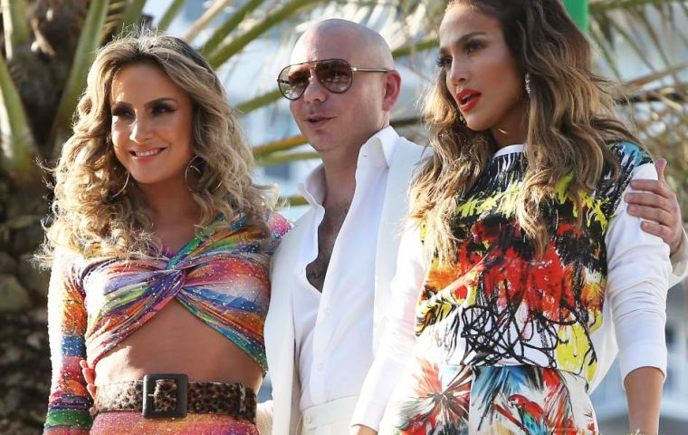 "The singer will perform ""We Are One (Ole Ola)"" together with Pitbull and Claudia Leitte"