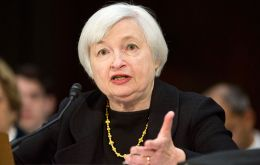 "As far as interest rates go, Ms Yellen said they would remain near zero ""for a considerable time"" after the bond buying ends."