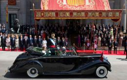 After the ceremony the king rode in an open Rolls Royce through central Madrid with his wife, Queen Letizia