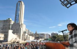 On Friday at the foot of the National Flag monument, Cristina Fernandez left aside the harsh rhetoric and called for dialogue