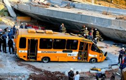 Two people were killed, at least 23 injured and several vehicles crushed by the collapsing tons of concrete