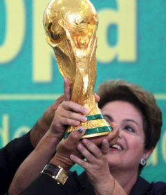 Dilma together with Putin and Zuma will be handing the World Cup to the winner. Putin since Russia hosts the next Cup in 2018 and Zuma because in 2010 it was played South Africa