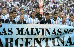 'Las Malvinas son Argentinas', before kick-off in a friendly against Slovenia in La Plata on June 7.