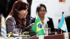 President Cristina Fernandez addressing her peers at the summit, where she criticized the conduct of the speculative funds