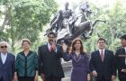 The family picture in Caracas next to the statue of Bolivar