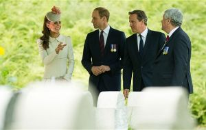 The Duke and Duchess of Cambridge, Prince Harry and David Cameron attended a twilight ceremony at St Symphorien Military Cemetery near Mons
