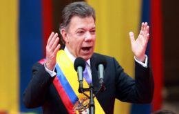"""Acts of peace, that's what the Colombian people ask for today,"" Santos said after receiving the sash of office"