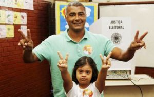 Romario went to vote with his daughter Ivy, who suffers from Down syndrome and has been one of the motives for his involvement in politics