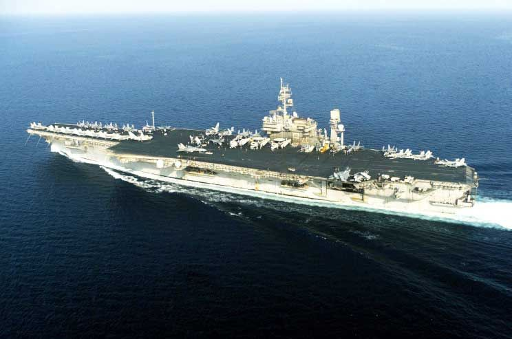 uss constellation carrier towed to the scrapyard along the