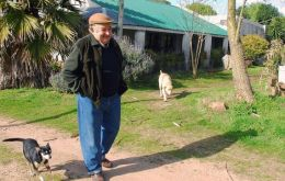 Mujica in his farm in the outskirts of Montevideo with his three-legged pet Manuela