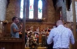 The Royal Marines band practicing the musical composition at Stanley's Cathedral