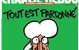 "The front page has an image of the Prophet Mohammad holding a sign saying ""Je suis Charlie"" below the headline ""Tout est pardonné""( All is forgiven"")."