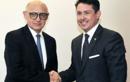 """Honored to represent the US in Argentina"" said Mamet, seen here shaking hands with foreign minister Timerman"