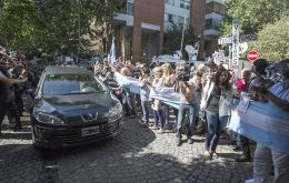 "Along the route people waved Argentine flags with black ribbons and held signs that said ""Justice,"" ""Thank you, Nisman"" and ""We all are Nisman""."