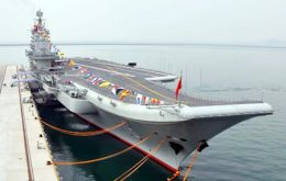 China's first aircraft carrier, the Liaoning, docks at a military port in Qingdao in east China's Shandong province.