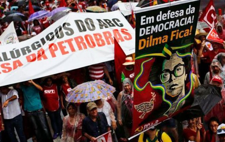 Police said 12,000 people blocked one of the main avenues of Sao Paulo, marching in defense of Petrobras and worker rights threatened by belt-tightening economic policies. (Pic Reuters)