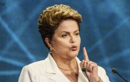 "In a closely watched speech in Brasilia, Rousseff said her under pressure government had to open ""dialogue"" with society and act with ""humility."""