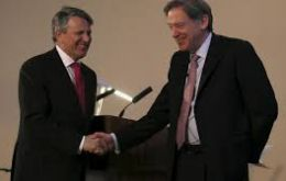 Ben van Beurden, CEO of Shell and Andrew Gould, Chairman of BG Group shake hands as Shell and BG their takeover deal at the London Stock Exchange