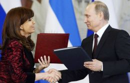 "Cristina Fernandez met with Putin in Moscow, and signed a raft of twenty cooperation accords in different fields and described bilateral ties as ""strategic""."