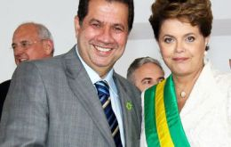 The former minister and chairman of the Democratic Labor Party next to the Brazilian president when her inauguration