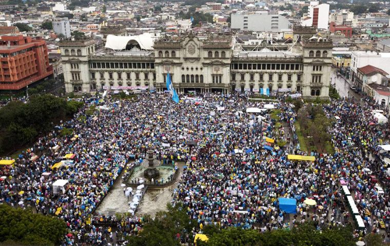 Despite the rain, demonstrators in 13 cities across the Central American nation banged drums and blew whistles in the peaceful protests.