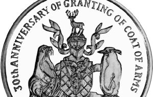 The coin, struck by the Pobjoy Mint, on behalf of the Treasury of South Georgia & the South Sandwich Islands includes the Coat of Arms.