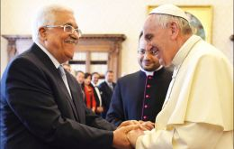 Pope Francis shakes hands with Palestinian Authority chief Mahmoud Abbas during a visit to the Vatican