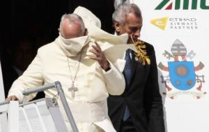 When Francis emerged, a breeze whipped off his white zucchetto cap and swirled his robes, but the pope took it in his stride, smiling and laughing