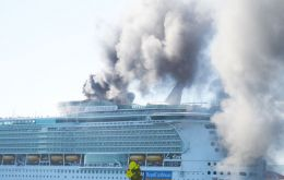 Black smoke could be seen billowing from the 1,112-foot Freedom of the Seas as it docked in Jamaica on Wednesday with 4.500 passengers.